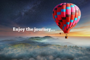 Colorful hot-air balloons flying over the mountain with with sta